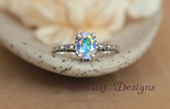 Hey, I found this really awesome Etsy listing at https://www.etsy.com/listing/109253468/opalescent-topaz-filigree-engagement