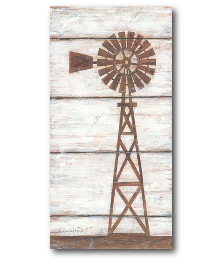 rustic farm windmill on shiplap.