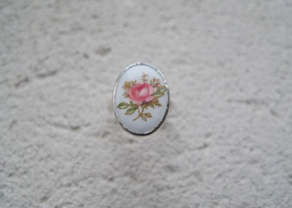 Painted Porcelain Flower Lost and Found.  This ring features a beautiful flower painted on porcelain, set in a bezel setting.