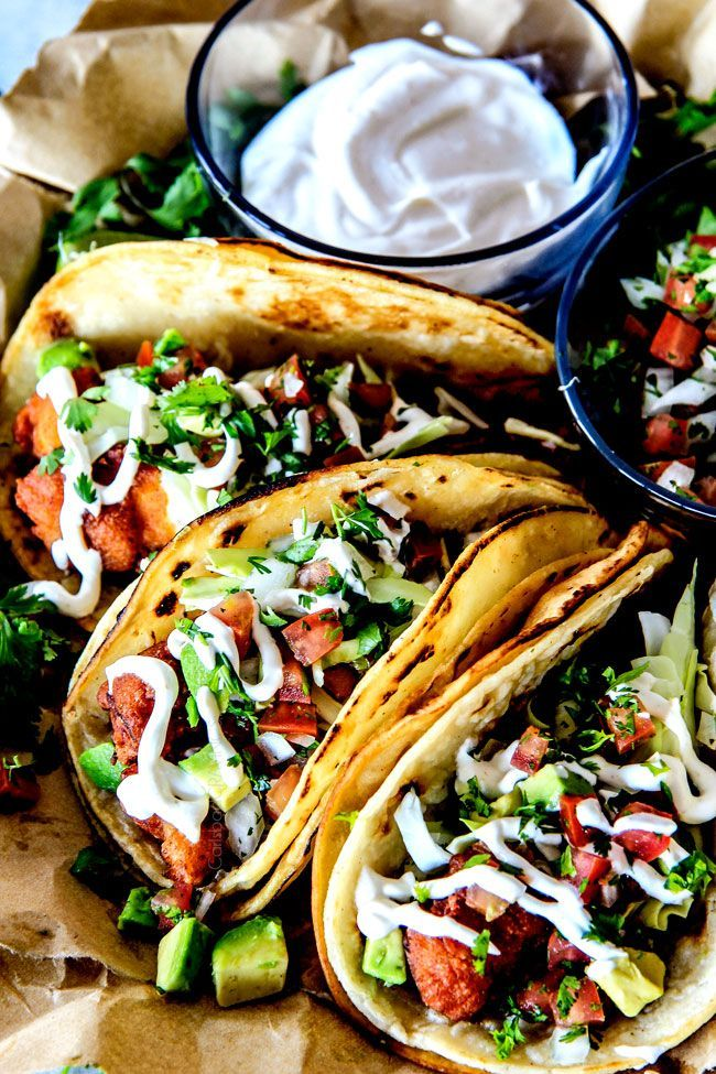 BETTER than any restaurant!!! Crispy fried Baja Fish Tacos with crunchy cabbage, fresh pico de gallo, and creamy white sauce all finished with tangy lime!