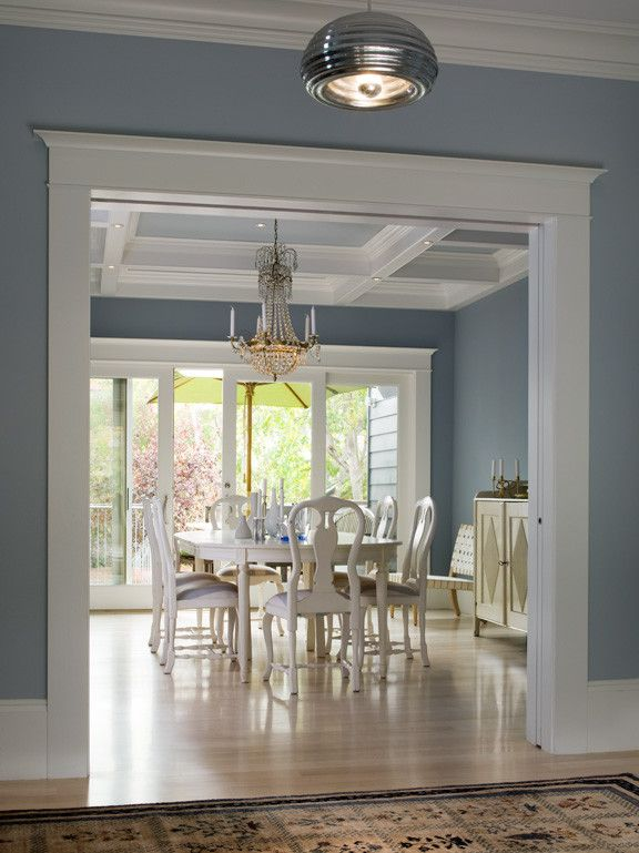 love the grey blue walls! dijejau poage construction dining room light gray blue walls wooden floors gold chandelier better decorating bible blog interiors white chairs waffle ceiling