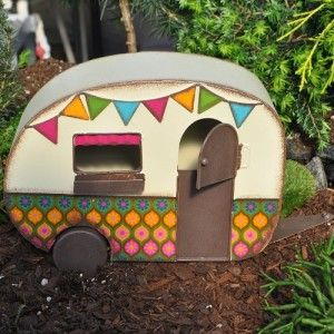 Miniature Fairy Garden Camper Trailer This Bohemian theme trailer comes with a hitch, two rolling wheels, and a door with a top section that opens.