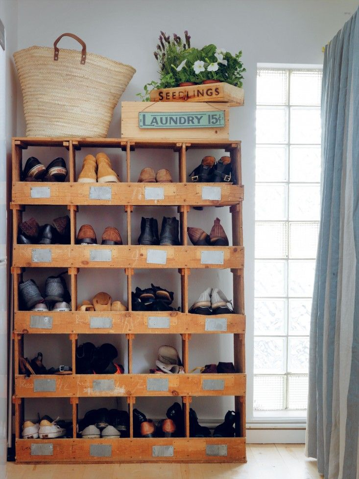 Required Reading: Living Beautifully by Cabbages and Roses founder Christna Strutt, Photograph by Simon Brown, shoe storage in vintage baker...