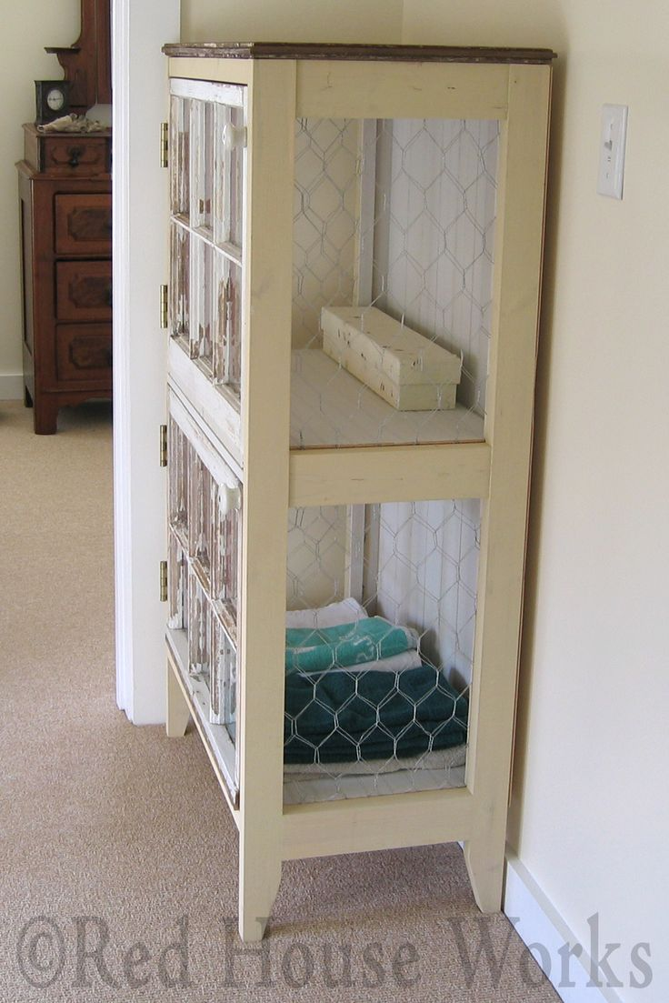 A Cupboard Made From Salvaged Materials - old barn wood, windows and chicken wire were used to make this cabinet.