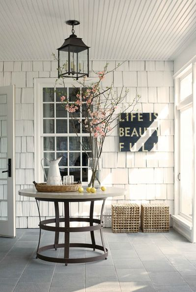 #shaker #white #entry #foyer #carriage #lighting #typography #art #round #table
