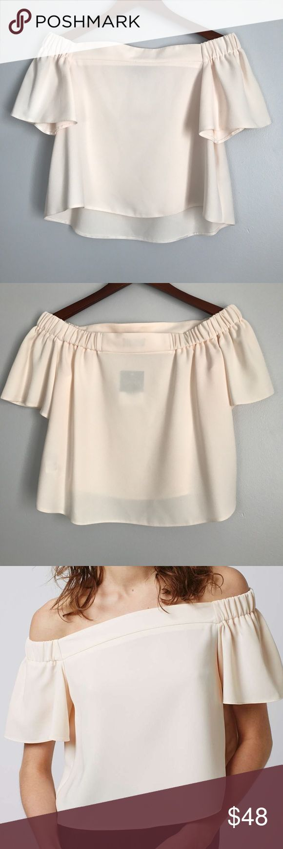Topshop Make Offer Livi Bardot Top Bare shoulders are still a favourite. Dress yours up with a structured clean shape in this pale peachy pink bardot top - perfect worn with denim and heels for a stylish finish. 100% Polyester. Machine wash. (NR21815) Topshop Tops