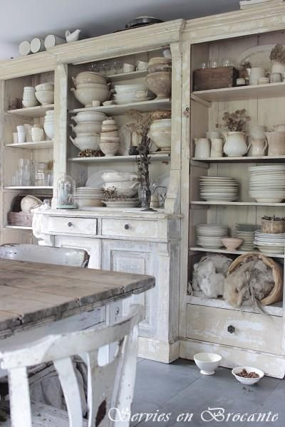 French farmhouse style cabinets that serve as both functional furniture and a beautiful display for dishes.