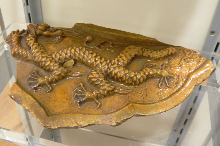 Dragon Roof Tile, 19th century: this eave tile from the old Imperial Palace in Nanking (Nanjing) shows the five clawed yellow imperial dragon associated with the Emperor of China. Only the Emperor and those in the servise of the empire could use this dragon emblem