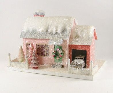 """A cute pink house with plenty of batting and glitter snow. - 15"""" x 11"""" x 10"""". - Pressed paper, mica glitter, batting and bottle brush. - Imported."""