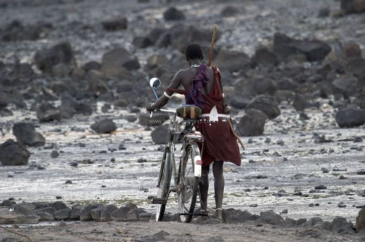 Great Rift Valley Kenya - Man pushing a bicycle  #africa #greatriftvalley #kenya #wilderness #shompole #accommodation #hotel #experience #wildlife #travel #traveltherenext