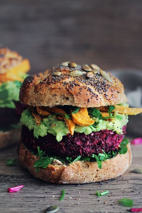 quinoa beet burger with avocado & tahini dressing and sweet potato fries