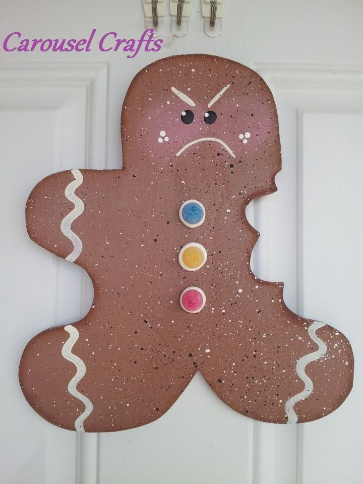 Cute Angry Gingerbread because someone took a bite out of him. Hanging Wood Cutout Christmas. By Carousel Crafts