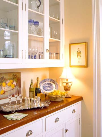 The Versatile Butler's Pantry. The traditional location for a butler's pantry is in a short hallway between the kitchen and dining room. This allows easy access to glassware and silver and provides a surface to set out appetizers, drinks, or dessert.