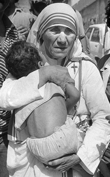 Mother Teresa hugs a child in West Beirut in 1982.