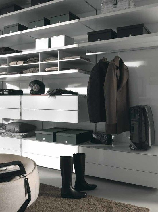 Luxurious CLOSETS Finished With Modern Design Equipped With Cream Rug Design With White Drawers Unit Idea