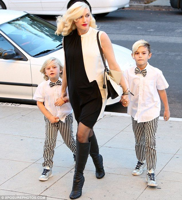 Holiday style: Gwen Stefani took her sons Kingston and Zuma to a Los Angeles church on Christmas Eve in matching black-and-white outfits