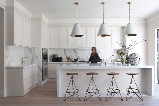 modern white kitchen with marble on the backsplash by greencouch