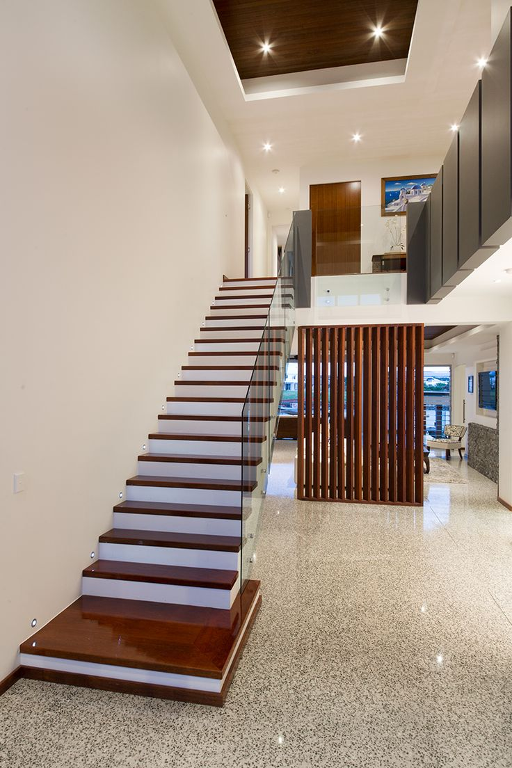 Foyer and timber stairs polished concrete floor