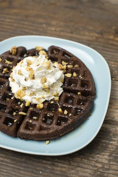 Have some decadent dessert for Breakfast with a Waffle Brownie! Ingredients: 1 box brownie mix, 1/4 cup water, 1/2 cup vegetable oil, 2 eggs, Maple syrup, Whipped cream, Chopped walnuts