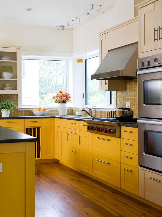 Yellow cabinets with wood flooring