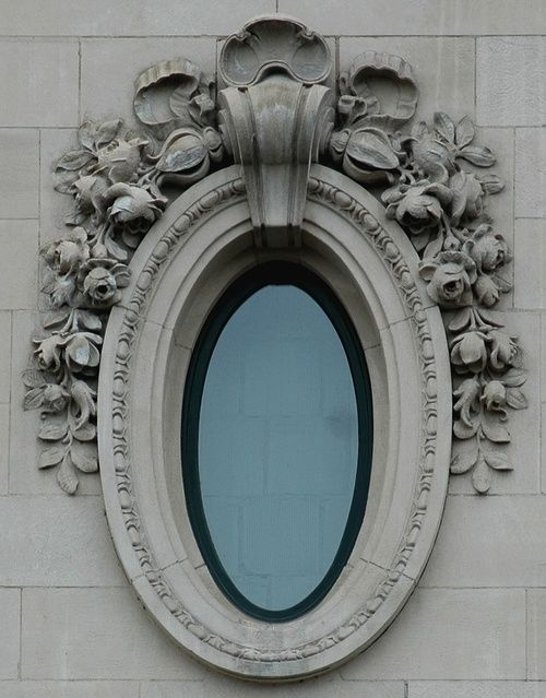 architectural detail: oval window with lovely details, looks a bit like an oversized photo frame.