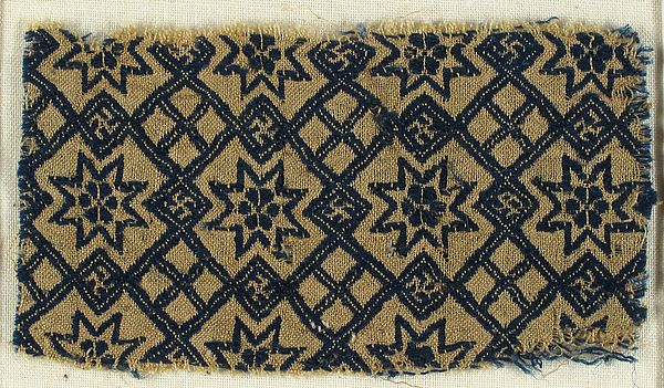 Textile with Stars and Swastika Date: 15th century Culture: German Medium: Silk, wool Dimensions: Overall: 1 3/4 × 3 1/8 in. (4.5 × 8 cm) Storage (Mat): 5 1/2 × 8 1/2 in. (14 × 21.6 cm) Classification: Textiles-Woven Credit Line: Rogers Fund, 1909 Accession Number: 09.50.1262