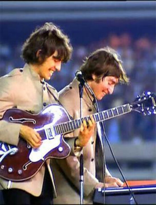George and John - gorgeous guitar, hollow body rich brown with white pickguard. MUSIC STRINGS OF HISTORY - https://www.pinterest.com/DianaDeeOsborne/music-strings-of-history/ - Gorgeous smiles too as Beatles band members have fun in maybe 1970s.