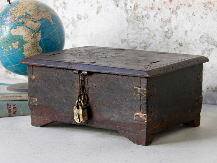 Wooden Money Box with two slots in its top. The lid opens to reveal small compartments. This box would have been used by merchants as a cash box. Add an authentic antique padlock for the perfect look.