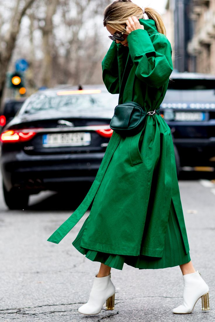 Monochrome emerlad green coat and pleated skirt, fannypack and pristine white boots. |Milan Fashion Week Street Style Fall 2018 Day 5 - The Impression