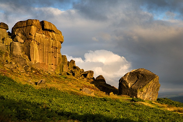 Clouds Clearing Over Cow and Calf Rocks  Ilkley Moor  An early start was required for this summer sunrise. As dawn broke the rocks looked flat under a cloudy sky, but suddenly the clouds started to clear producing this dramatic scene.