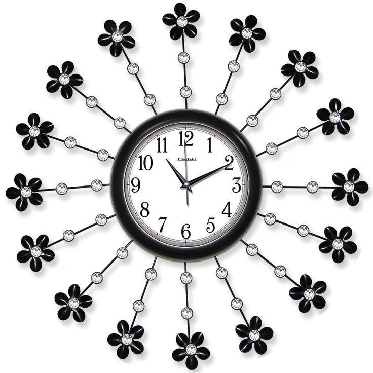 Taşlı Ferforje Metal Çiçek Duvar Saati  Ürün Bilgisi ;  Ürün maddesi : Metal gövde, gerçek cam Ebat : 62 cm  Mekanizması : Akar saniye, sessiz çalışır Garanti : Saat motoru 5 yıl garantili Taşlı Ferforje İlginç Duvar Saati Üretim  : Yerli üretim Kullanım ömrü uzundur Kalem pil ile çalışmakta Ürün fotoğrafta görüldüğü gibi olup orjinal paketindedir Sevdiklerinize hediye olarak gönderebilirsiniz