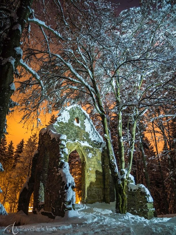 Early evening at the old ruin next to Lac Sinclair, Chamonix. The glow in the background is from the town light glowing orange in the evening fog. Discovered by Jan Venter at Lac Sinclair, Chamonix, France