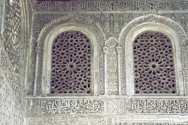 Image SPA 0311 featuring decorated area from the Alhambra, in Granada, Spain, showing Geometric PatternFloriated Arabesque and Calligraphy using stucco or plasterwork.