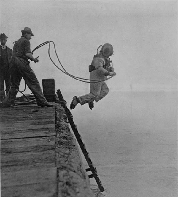 "A deep sea diver is captured mid-jump. This photo made the cover of Scientific American Supplement on October 23, 1915 with the caption: ""A diver in full costume making a sensational descent."""