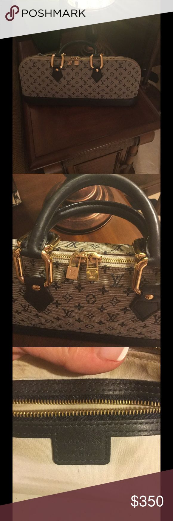 AUTH LOUIS VUITTON NAVY GRAY CANVAS ALMA BAG AUTH LOUIS VUITTON  NAVY GRAY CANVAS MONOGRAM ALMA LONG HANDBAG. GOOD CONDITION SMALL AMOUNT OF STAINS ON INSIDE AND SMALL SCRATCHES ON BOTTOM SEE LAST THREE PICTURES Louis Vuitton Bags Satchels