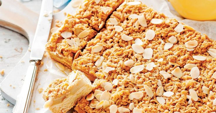 A sugary crumbed coating and sprinkling of roasted flaked almonds add texture and sweetness to this gooey apple slice.