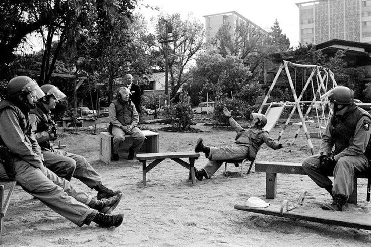 Alameda County Sheriffs deputies kick back in Peoples Park after clearing out the occupants on May 15 1969