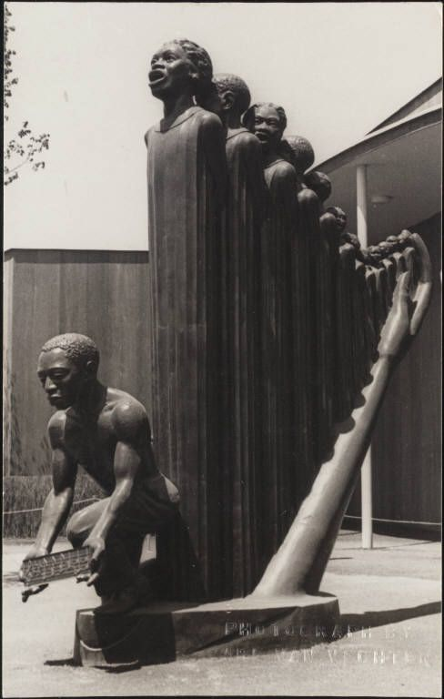 """Lift Every Voice and Sing"" sculpture was designed as a temporary installation in the 1939 World's Fair, by Harlem Renaissance artist and sculptress Augusta Savage. This piece stood 16 feet tall. Sadly, like many fair displays it was destroyed at the close of the event. Thankfully we have this photo, that the whole world can enjoy it now and forever."