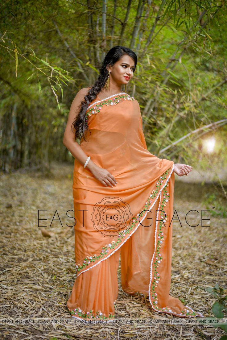 PRICE: INR 9,632.00; US$ 145.94 To buy click here: https://goo.gl/uIfTuq Featuring the Tangerine Garden saree in 100% flat, pure silk chiffon in warm orange and floral ribbonwork embroidery that is sublimely romantic and exudes sophisticated elegance. The edges are decorated with enamoring thin, delicate, white lace. The blouse back has a white lace false closure and white buttons for the perfectly feminine finish. Reach us at care@eastandgrace.com. With Love, EAST & GRACE…