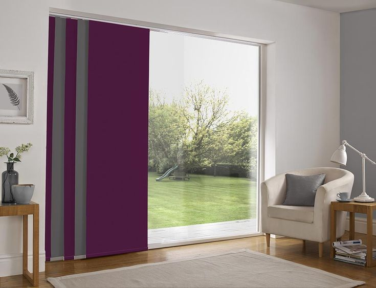 Panel blind is the most innovative shading solution for larger windows and patio doors. This blind also looks stunning as a stylish room divider. Here in plum and grey colour. Bolton Blind's panel blind is available in a diverse range of designs and fabrics including, sheer voiles and faux suede, all of which will enhance the decor of any room.