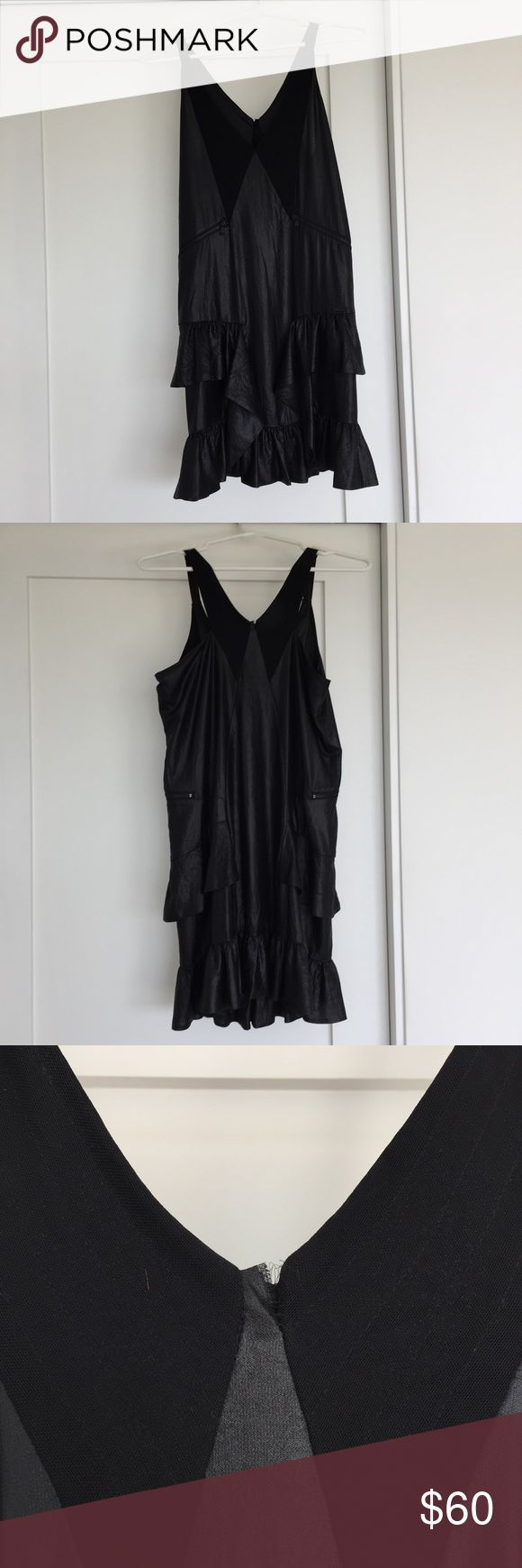 DIESEL black dress This DIESEL dress is super fun. It has zipper accents and is a mix of shiny and stitched fabric. It's got cute ruffles at the bottom too! There is a small tear in the stitching in the back/top of the dress but it's only been worn one time and is in great condition besides that. Diesel Dresses Mini