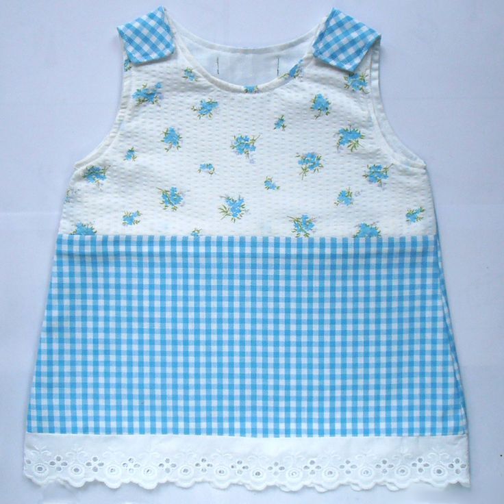 Sweet dress with flowers and small checked blue cotton. 25,-