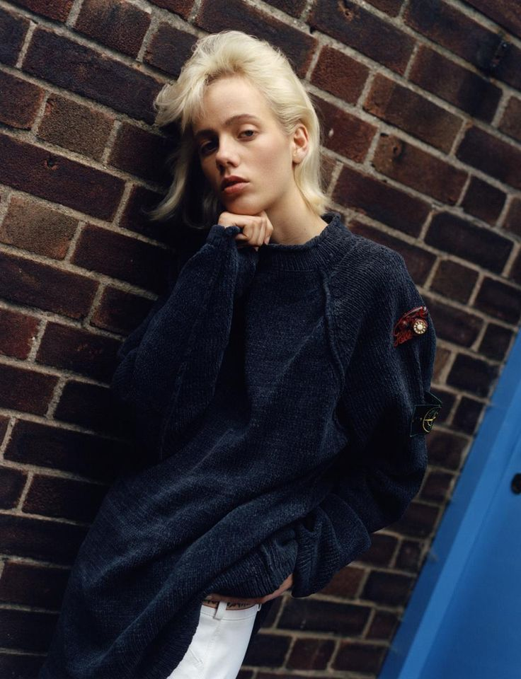 Model Marjan Jonkman wears Jumper vintage Stone Island from Massimo Osti Archive. Trousers Marni. Brooch and belt Vintage from Napthalene Textiles. Photography Theo Sion
