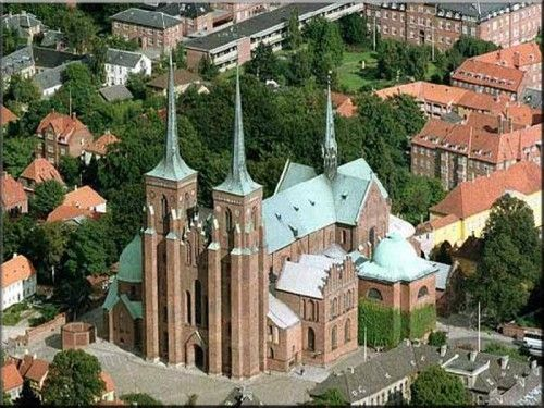 Roskilde Cathedral in Denmark. Built in the 12th and 13th centuries, Roskilde Cathedral was Scandinavia's first Gothic cathedral to be built of brick and it encouraged the spread of this style throughout northern Europe. It has been the mausoleum of the Danish royal family since the 15th century.