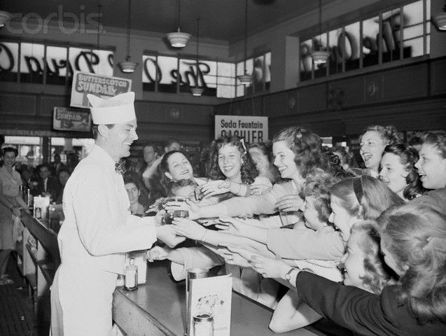 Dana Andrews being mobbed by dozens of screaming Hollywood High School students. He took a job at a soda fountain to bring more realism to his role in The Best Years Of Our Lives. But they knew who he really was. :)