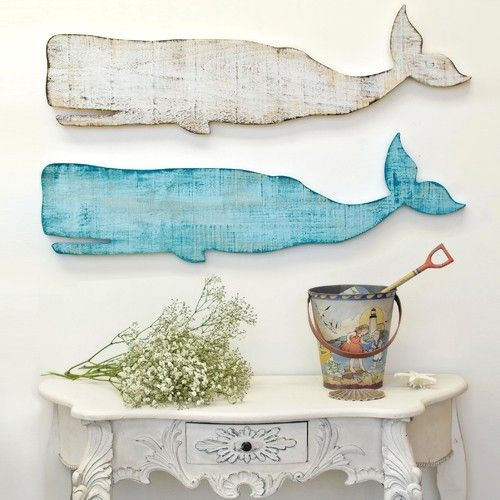Love these whales! And the vintage sand pail is the perfect finishing touch!One of the best parts about the beachy style in your home is the accessories; you can have such fun with them! #beachy #beachhouse