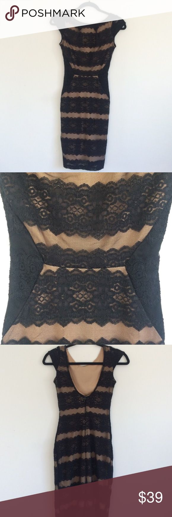 Lace Bodycon Stunner Body hugging black lace dress with nude lining. Zips up in the back and fits like an xs/s or size 0. Worn once to a wedding, in perfect condition. Dresses