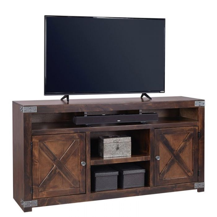 "The Aspen Home Urban Farmhouse 65"" TV Console from Aspen Home has a rustic design with a brown finish. Perfect for managing your living room essentials and electronics with spacious top, 2 cabinet doors with interior storage, and 3 cubby style shelves with grommet holes to easily facilitate and maintain cable management. 