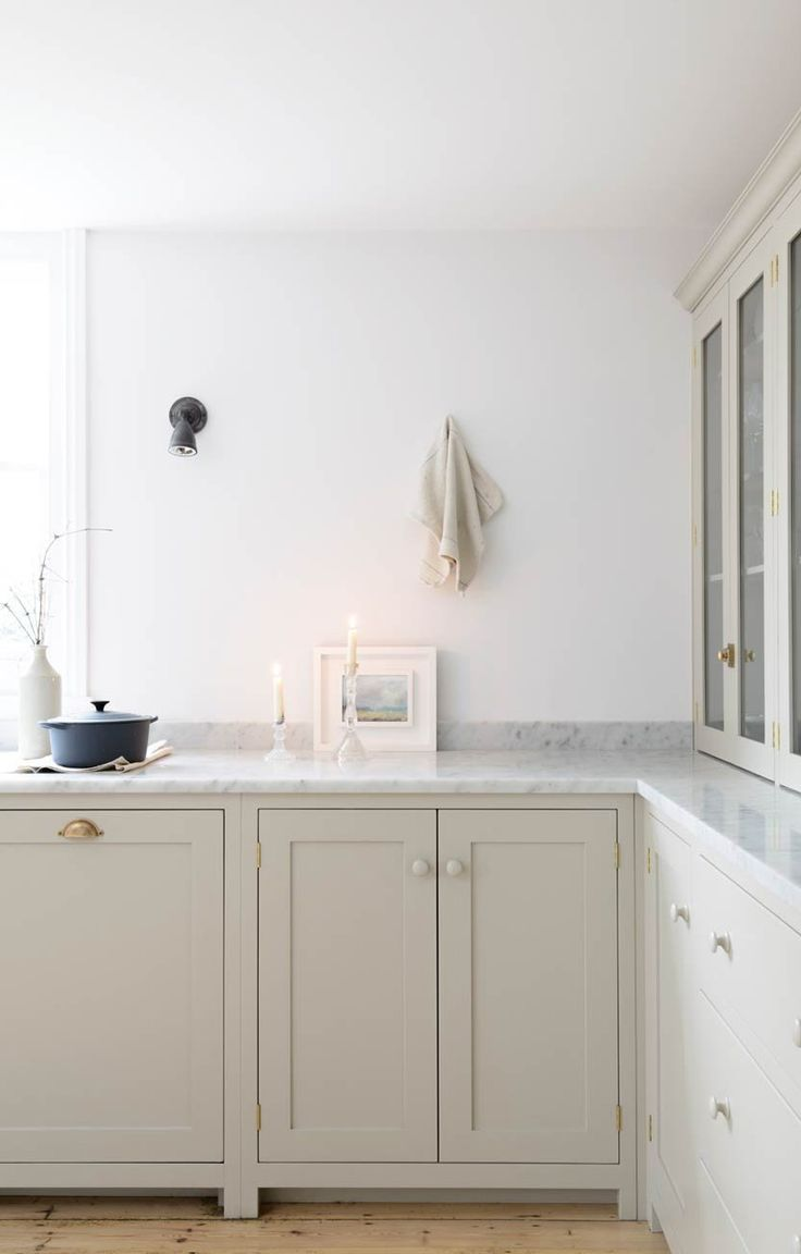 countertop cupboards and honed carrara marble in devols brighton shaker kitchen