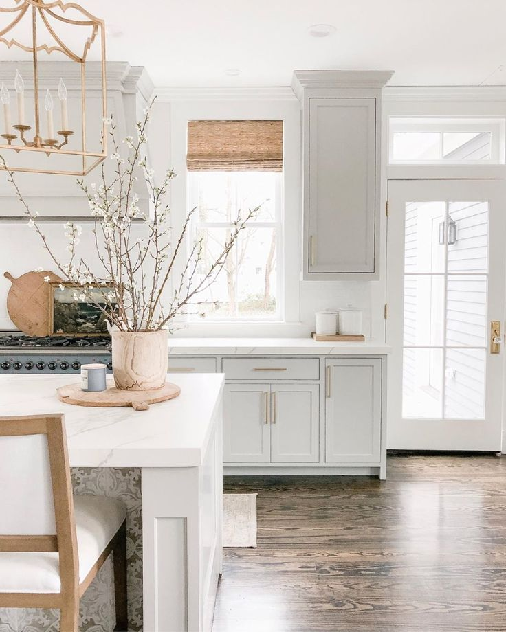 76a254eb33627d71904c8a31d71fcd58 Elegant white farmhouse kitchen with Benjamin Moore Repose Grey cabinets, subway...